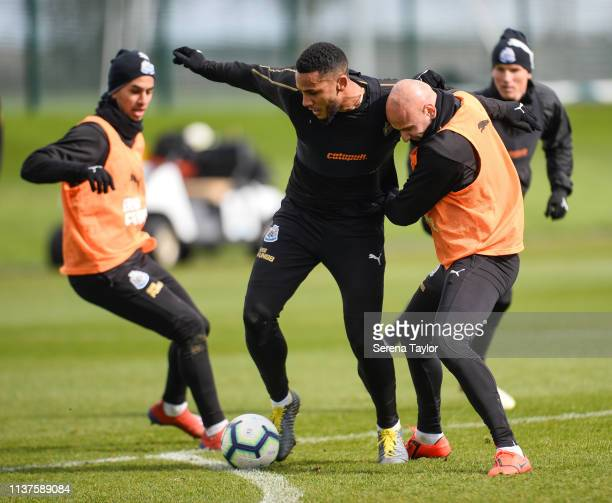 Jamaal Lascelles and Jonjo Shelvey jostle for the ball during the Newcastle United Training Session at the Newcastle United Training Centre on March...
