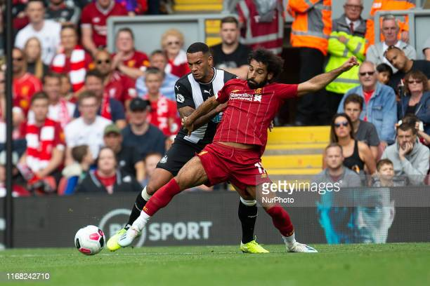 Jamaal Lascelles battling with Mohamed Salah of Liverpool during the Premier League match between Liverpool and Newcastle United at Anfield Liverpool...