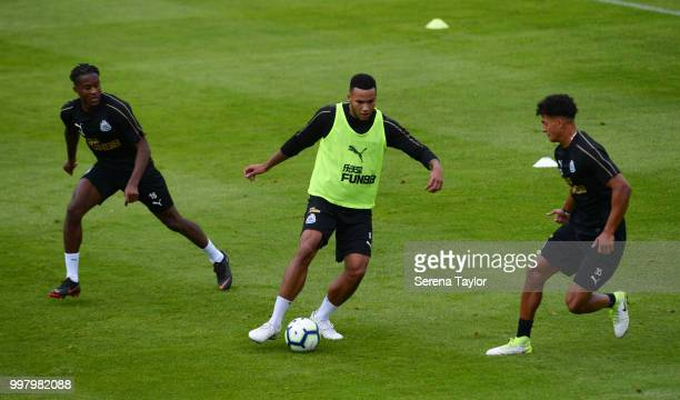 Jamaal Lascelles controls the ball whilst being challenged by Rolando Aarons and Josef Yarney during the Newcastle United Training session at Carton...