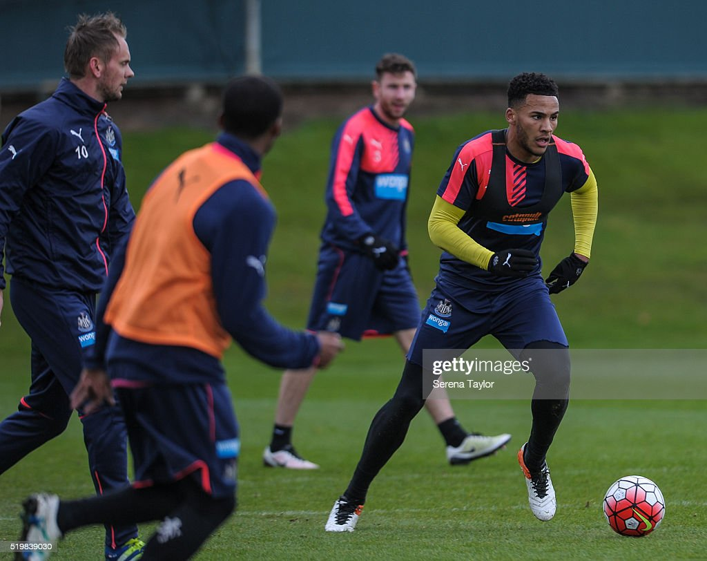 Jamaal Lascelles (R) looks to pass the ball during the Newcastle United Training session at The Newcastle United Training Centre on April 8, 2016 in Newcastle upon Tyne, England.
