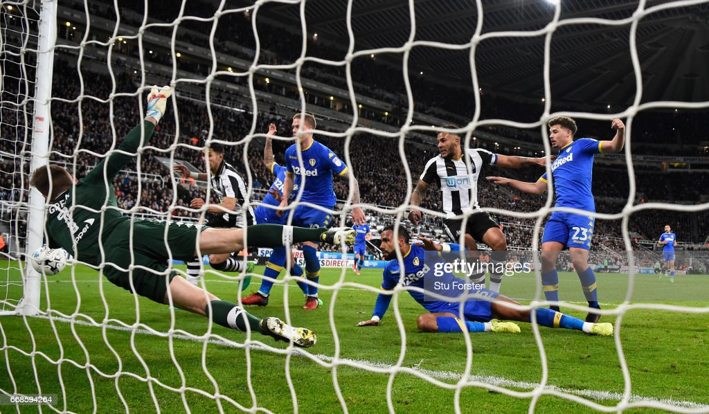 Jamaal Lascelles of Newcastle (2nd r) scores the first goal during the Sky Bet Championship match between Newcastle United and Leeds United at St James' Park on April 14, 2017 in Newcastle upon Tyne, England.