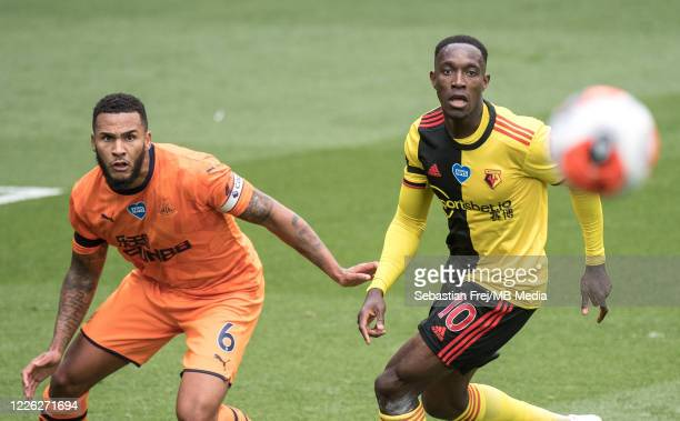Jamaal Lascelles of Newcastle United and Danny Welbeck of Watford FC in action during the Premier League match between Watford FC and Newcastle...