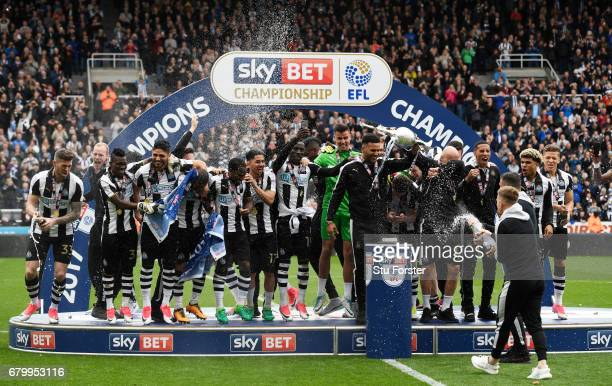 Jamaal Lascelles of Newcastle United and Jonjo Shelvey of Newcastle United celebrate with the Championship Trophy after the Sky Bet Championship...