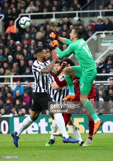Jamaal Lascelles of Newcastle United and Martin Dubravka of Newcastle United look to clear the ball during the Premier League match between Newcastle...