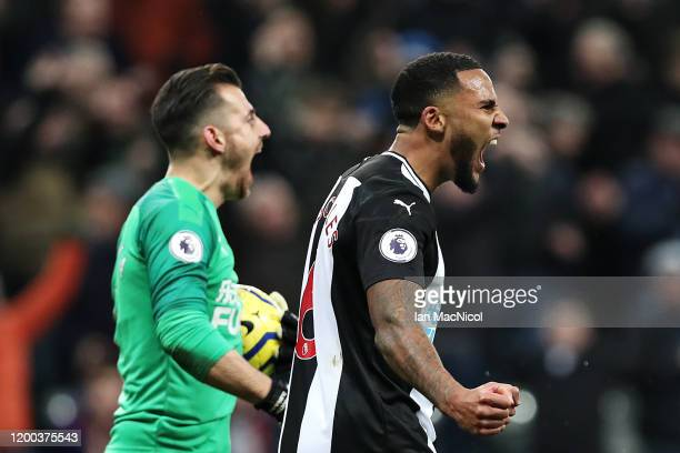 Jamaal Lascelles of Newcastle United and teammate Martin Dubravka celebrate seeing their side score the opening goal during the Premier League match...