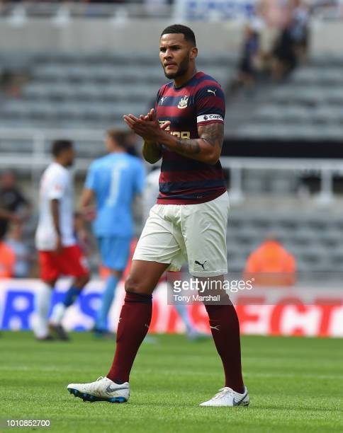 Jamaal Lascelles of Newcastle United applauds the fans at the end of the PreSeason Friendly match between Newcastle United and FC Augsburg at St...