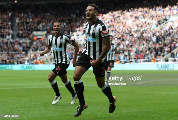 Jamaal Lascelles of Newcastle United celebrates after he scores the winning goal during the Premier League match between Newcastle United and Stoke...