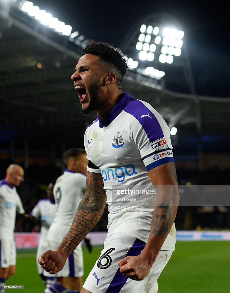 Jamaal Lascelles of Newcastle United celebrates as Mohamed Diamé of Newcastle United scores their first goal during the EFL Cup Quarter-Final match between Hull City and Newcastle United at KCOM Stadium on November 29, 2016 in Hull, England.