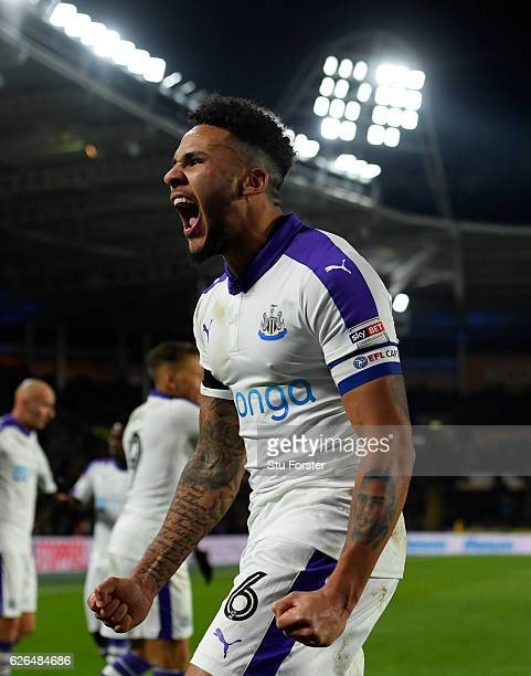 Jamaal Lascelles of Newcastle United celebrates as Mohamed Diamé of Newcastle United scores their first goal during the EFL Cup QuarterFinal match...