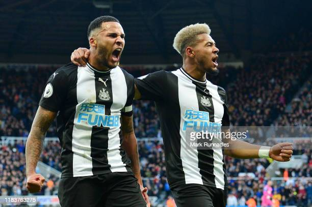 Jamaal Lascelles of Newcastle United celebrates with Joelinton of Newcastle United after he scores his sides first goal during the Premier League...