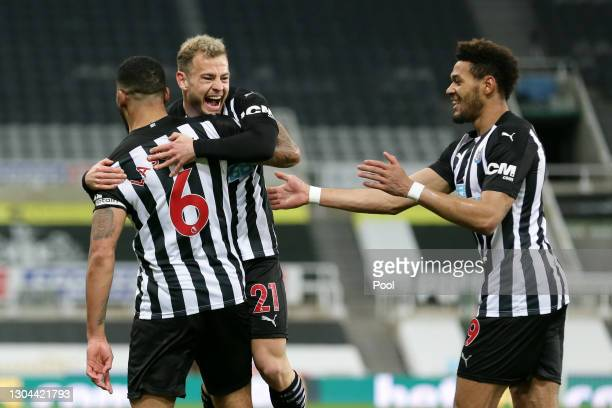 Jamaal Lascelles of Newcastle United celebrates with team mates Ryan Fraser and Joelinton after scoring their side's first goal during the Premier...