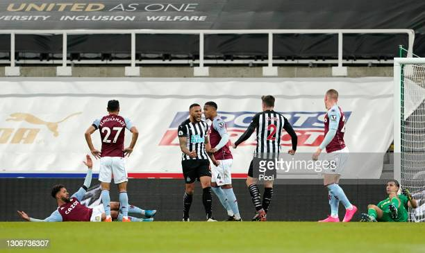 Jamaal Lascelles of Newcastle United celebrates with teammate Ciaran Clark of Newcastle United after scoring their team's first goal during the...