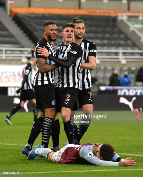 Jamaal Lascelles of Newcastle United celebrates with teammates Ciaran Clark and Andy Carroll of Newcastle United after scoring their team's first...