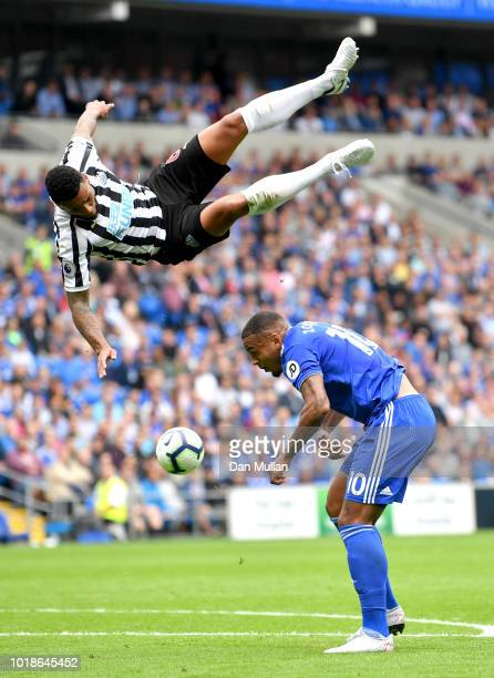 Jamaal Lascelles of Newcastle United challenges for the ball with Kenneth Zohore of Cardiff City during the Premier League match between Cardiff City...