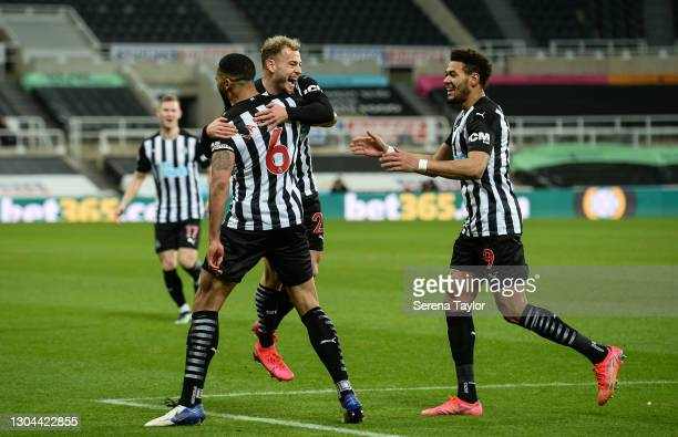 Jamaal Lascelles of Newcastle United FC celebrates with teammates Ryan Fraser and Joelinton after scoring the opening goal during the Premier League...