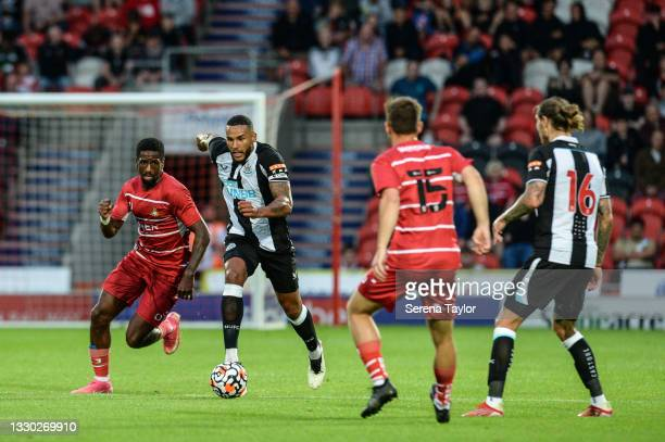 Jamaal Lascelles of Newcastle United FC runs with the ball during the Pre Season Friendly between Doncaster Rovers and Newcastle United at the...