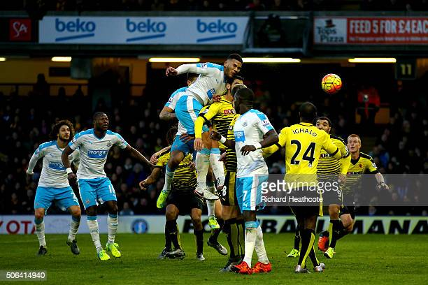 Jamaal Lascelles of Newcastle United heads the ball to score his team's first goal during the Barclays Premier League match between Watford and...