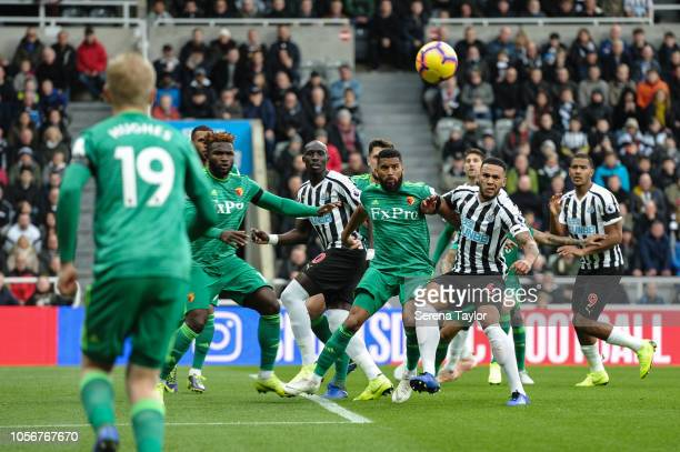 Jamaal Lascelles of Newcastle United jostles with Adrian Mariappa of Watford FC for the ball during the Premier League Match between Newcastle United...