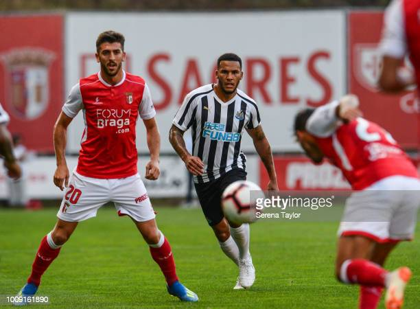 Jamaal Lascelles of Newcastle United looks to closed down Paulinho of SC Braga as the ball is headed towards him during a pre season friendly between...