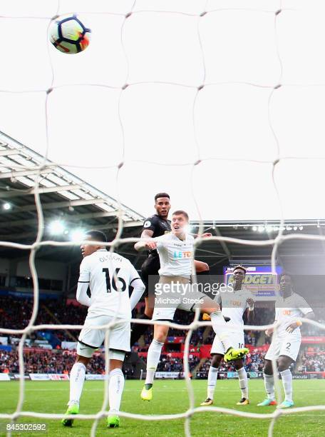 Jamaal Lascelles of Newcastle United scores his sides first goal during the Premier League match between Swansea City and Newcastle United at Liberty...