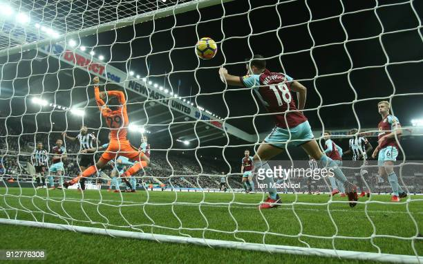 Jamaal Lascelles of Newcastle United scores his team's first goal during his first Premier League match between Newcastle United and Burnley at St...