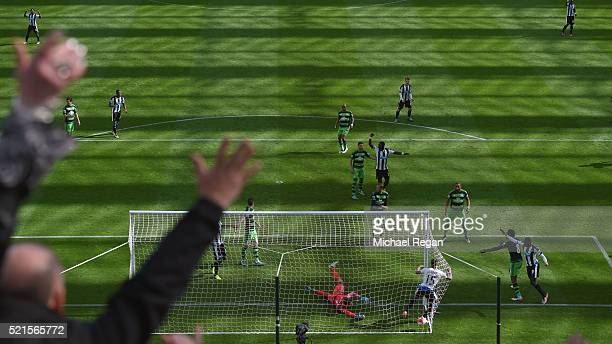 Jamaal Lascelles of Newcastle United scores his teams first goal during the Barclays Premier League match between Newcastle United and Swansea City...
