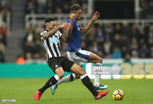 Jamaal Lascelles of Newcastle United tackles Dominic CalvertLewin of Everton during the Premier League match between Newcastle United and Everton at...