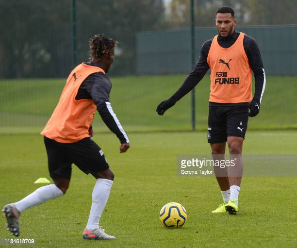 Jamaal Lascelles passes the ball to Christian Atsu during the Newcastle United Training Session at the Newcastle United Training Centre on October...