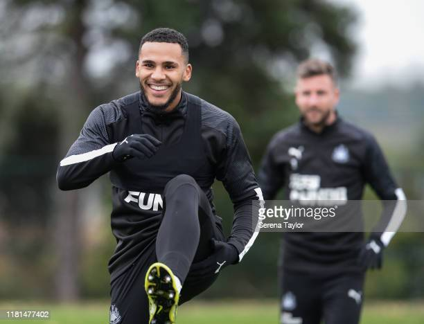 Jamaal Lascelles smiles as he warms up during the Newcastle United Training Session at the Newcastle United Training Centre on October 16 2019 in...