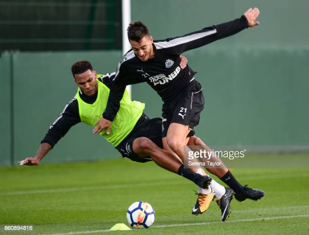 Jamaal Lascelles tackles Joselu during the Newcastle United Training session at the Newcastle United Training Centre on October 13 in Newcastle...