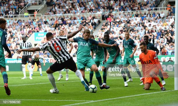 Jamaal Lescelles of Newcastle United is tackled by Jan Vertonghen of Tottenham Hotspur during the Premier League match between Newcastle United and...