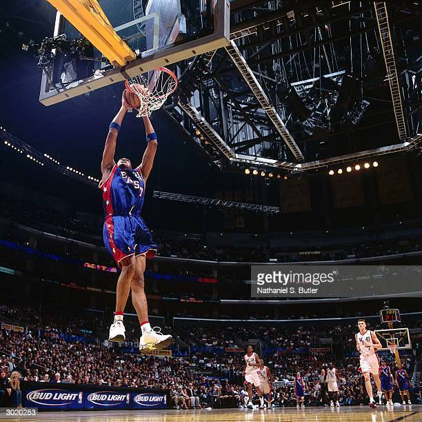 Jamaal Magloire of the Eastern Conference AllStars dunks against the Western Conference AllStars during the 2004 AllStar Game on February 15 2004 at...