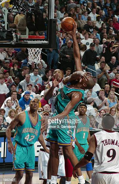 Jamaal Magloire of the New Orleans Hornets draws a foul from Derrick Coleman of the Philadelphia 76ers in Game one of the Eastern Conference...