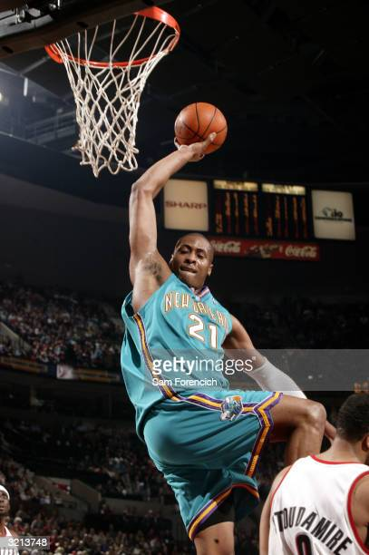 Jamaal Magloire of the New Orleans Hornets goes up for a dunk during a game against the Portland Trail Blazers on April 3 2004 at the Rose Garden...