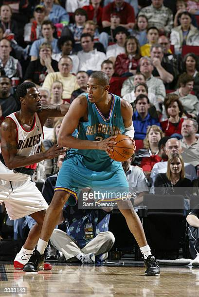 Jamaal Magloire of the New Orleans Hornets looks to play the ball against Dale Davis of the Portland Trail Blazers during the game at the Rose Garden...