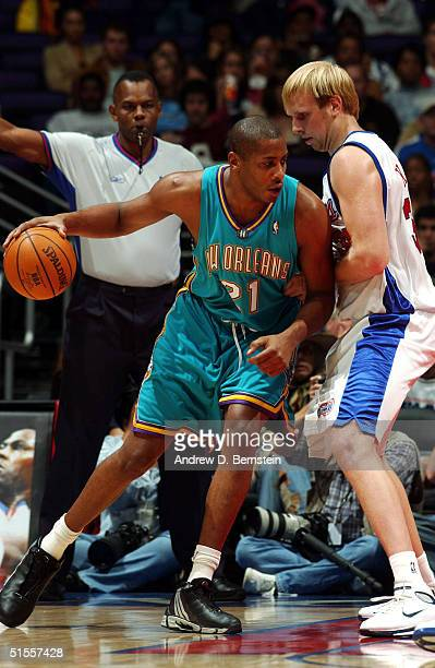 Jamaal Magloire of the New Orleans Hornets posts up against Chris Kaman of the Los Angeles Clippers at the Staples Center on October 24 2004 in Los...