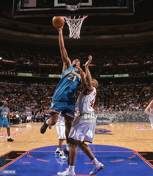 Jamaal Magloire of the New Orleans Hornets takes the layup against Derrick Coleman of the Philadelphia 76ers in Game 2 of the Eastern Conference...