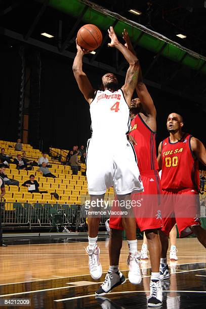 Jamaal Tatum of the Idaho Stampede gets past Derrick Dial and Chris Ellis of the Tusla 66ers for a basket at McKay Events Center during the NBA...