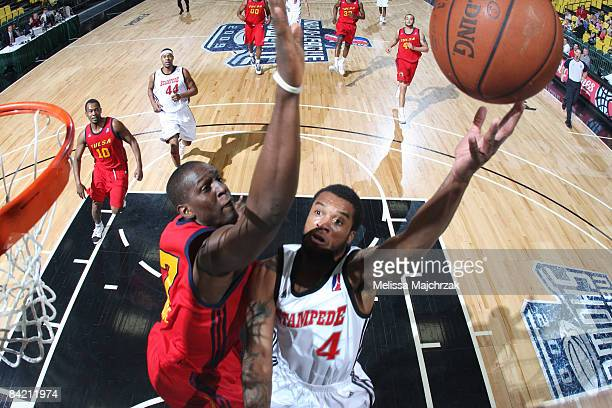 Jamaal Tatum of the Idaho Stampede goes up for a shot against Moses Ehambe of the Tulsa 66ers at McKay Events Center during the NBA DLeague Showcase...