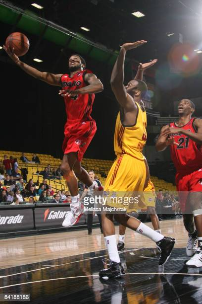 Jamaal Tatum of the Idaho Stampede swings a shot around Chris Hunter of the Fort Wayne Mad Ants during Day Two of the DLeague Showcase at McKay...