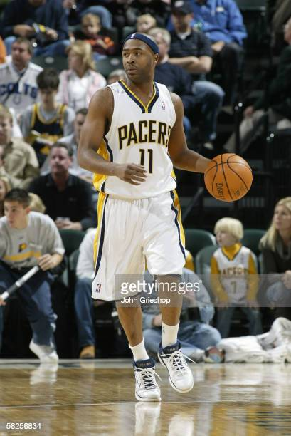 Jamaal Tinsley of the Indiana Pacers brings the ball up court against the New Jersey November 11, 2005 at Conseco Fieldhouse in Indianapolis,...