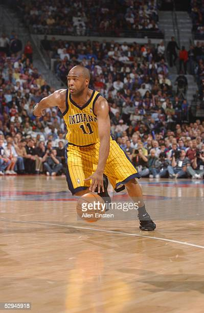 Jamaal Tinsley of the Indiana Pacers dribbles against the Detroit Pistons in Game two of the Eastern Conference Semifinals during the 2005 NBA...