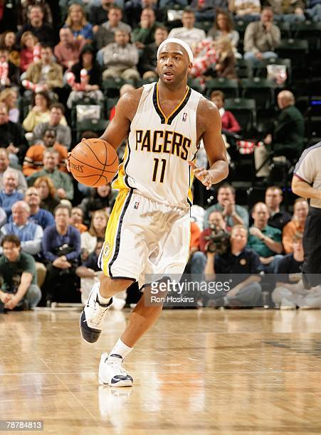 Jamaal Tinsley of the Indiana Pacers dribbles the ball against the Chicago Bulls at Conseco Fieldhouse on December 12, 2007 in Indianapolis, Indiana....