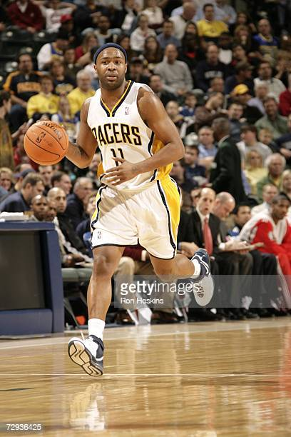 Jamaal Tinsley of the Indiana Pacers drives against the Houston Rockets at Conseco Fieldhouse December 26, 2006 in Indianapolis, Indiana. The Pacers...