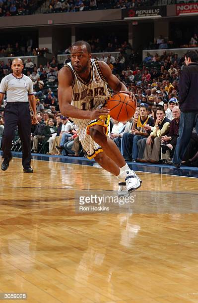 Jamaal Tinsley of the Indiana Pacers drives the baseline against the Toronto Raptors on March 9, 2004 at Conseco Fieldhouse in Indianapolis, Indiana....