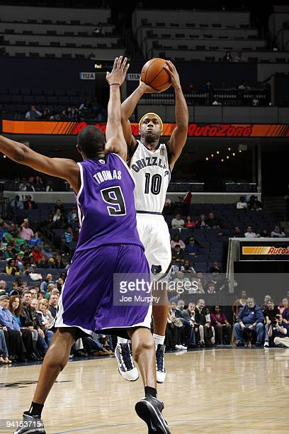 Jamaal Tinsley of the Memphis Grizzlies shoots a jump shot against Kenny Thomas of the Sacramento Kings during the game at the FedExForum on November...