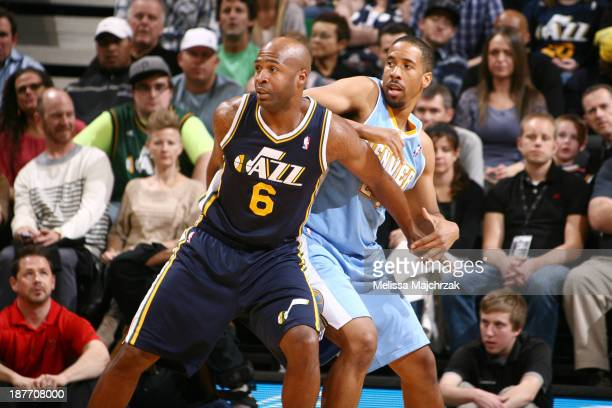 Jamaal Tinsley of the Utah Jazz battles for positioning against Andre Miller of the Denver Nuggets at EnergySolutions Arena on November 11 2013 in...
