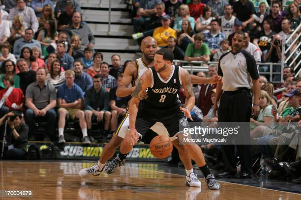 Jamaal Tinsley of the Utah Jazz defends against Deron Williams of the Brooklyn Nets at Energy Solutions Arena on March 30 2013 in Salt Lake City Utah...