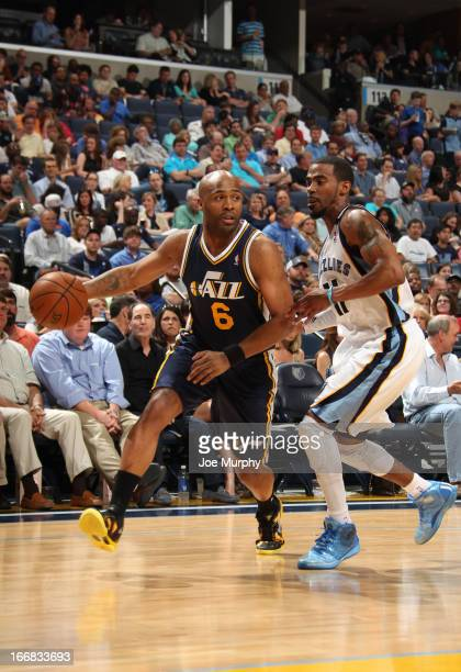 Jamaal Tinsley of the Utah Jazz drives against Mike Conley of the Memphis Grizzlies on April 17 2013 at FedExForum in Memphis Tennessee NOTE TO USER...