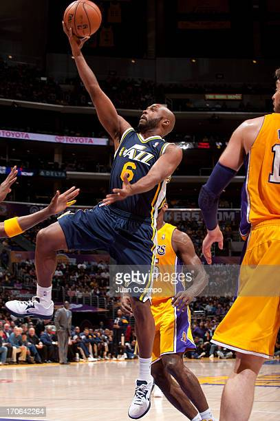 Jamaal Tinsley of the Utah Jazz goes to the basket during the game between the Utah Jazz and the Los Angeles Lakers at Staples Center on October 13...